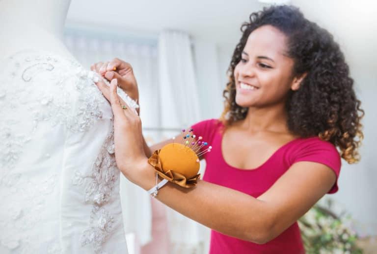 designer doing wedding dress alterations